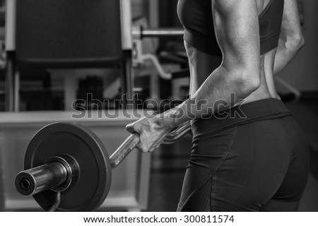 Power gym workout, women workout. Beautiful blonde trains in the gym - stock photo