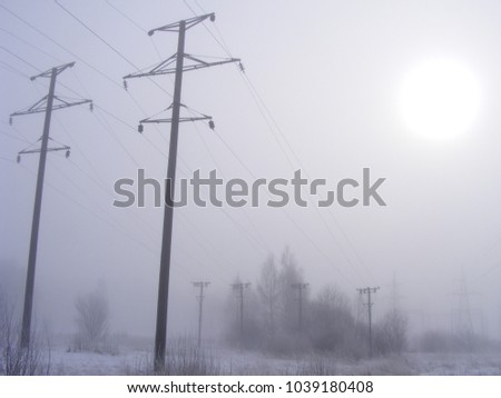 Power infrastructure during winter. Fog conditions.
