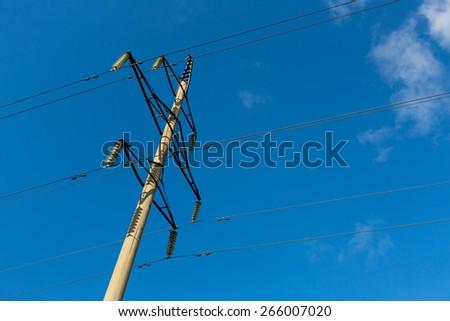 Power line against the blue sky - stock photo