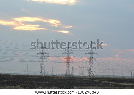 Power line at sunset, outskirts of St. Petersburg, Russia.