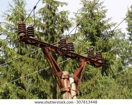 Power line column in spruce forest