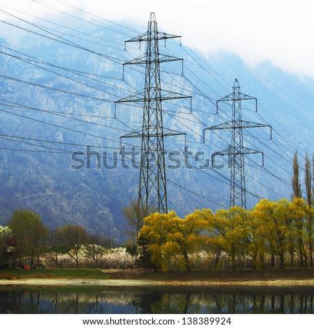 power line in spring mountain - stock photo