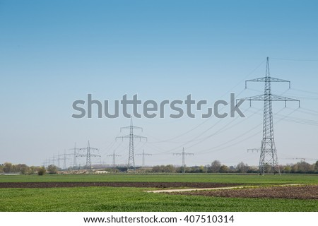Power line on a green meadow
