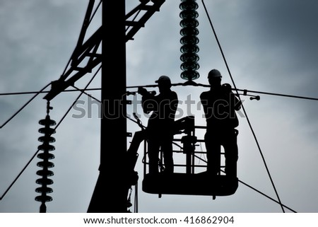 Power line support, insulators and wires. Appearance of a design. Assembly and installation of new support and wires of a power line. - stock photo