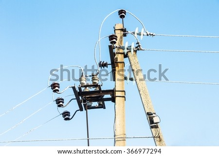 power line tower,frost on the wires, against blue sky