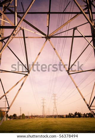 Power-lines against a pink sky - stock photo