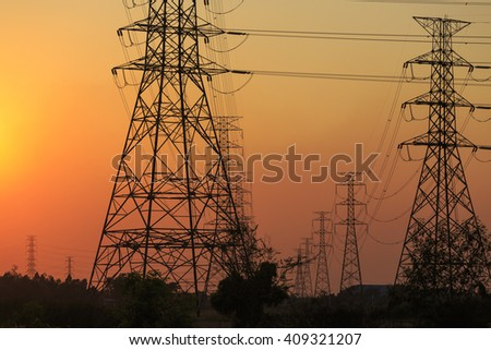 Power Lines And Electrical Towers Against Sunset Sky