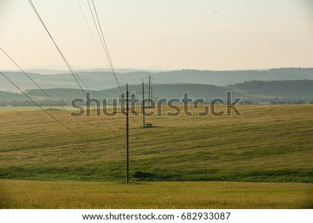 Power lines and hilly foothills