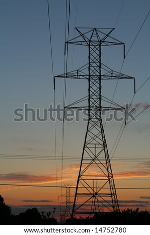 Power lines and towers against a sunset