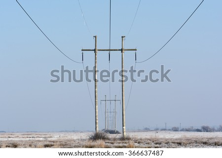 Power lines in a winter day