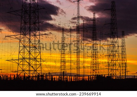 Power lines in the dusk - stock photo