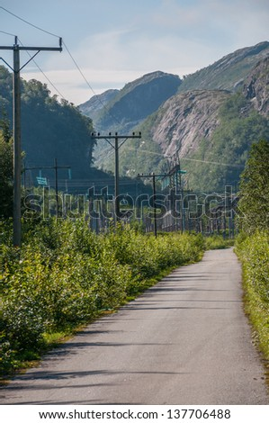 Power lines, mountains and country road, Bindalen, Nordland, Norway. - stock photo