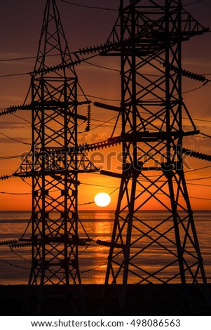 Power lines on a background of red sunrise light