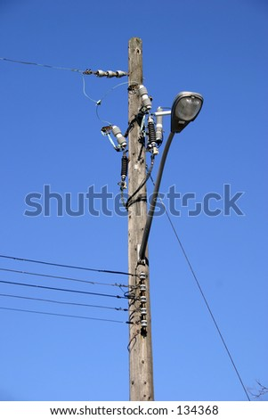 Power lines on a blue sky with lamp