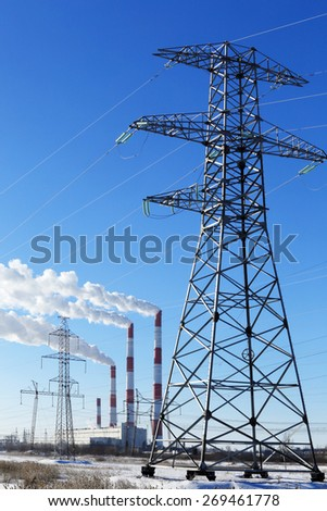 power lines on a sunny day on blue sky background in winter