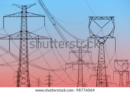 Power lines on evening sky - stock photo