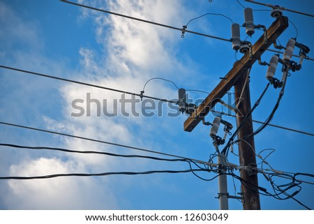 Power lines with blue sky - stock photo