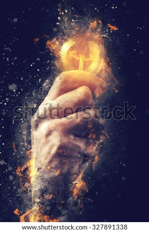 Power of creative energy and new ideas and understandings, hand with light bulb as metaphor of innovation and creativity, retro toned image, selective focus. - stock photo