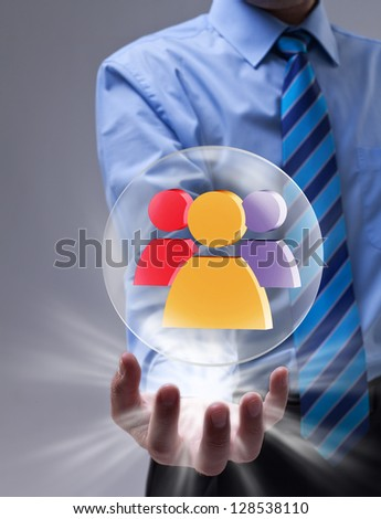 Power of social networking concept with glass sphere over businessman hand - stock photo