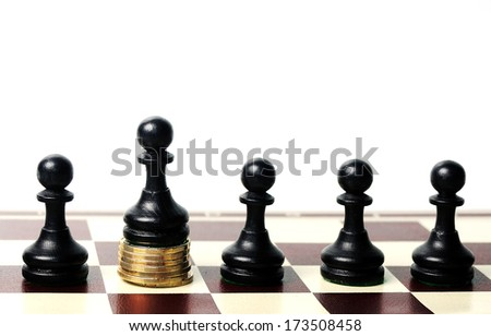 power of the money concept. Chess pawn standing  on the money  - stock photo