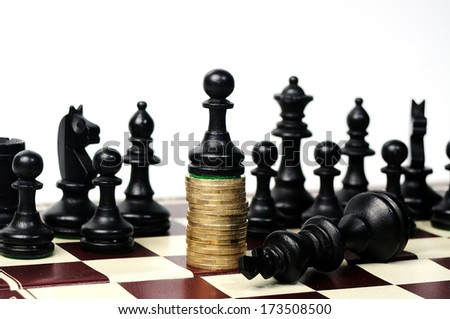 power of the money concept. Chess pawn standing  on the money wining the  king - stock photo