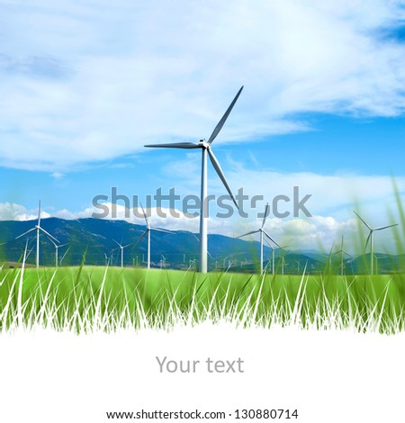 Power on blue sky and mountains with copyspace at the bottom - stock photo