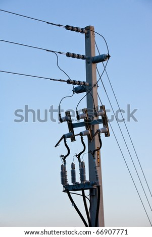 Power or telephone pole with wires, cords and cables in morning light