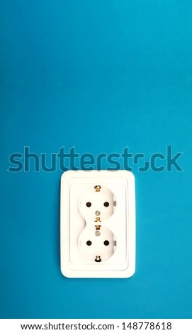 Power outlet on blue wall - stock photo