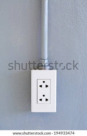 Power Outlet on cement wall - stock photo