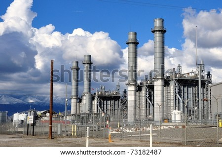 Power plant against cloudy blue sky - stock photo