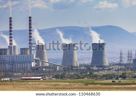 Power plant and electric lines - stock photo