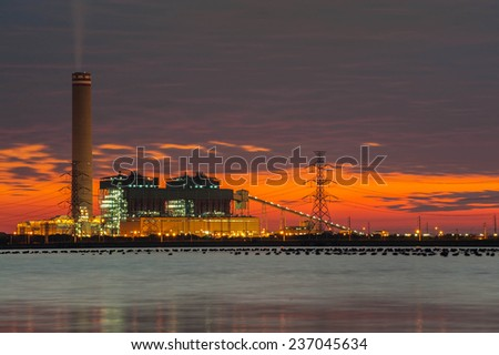 Power plant and natural petroleum gas refinery plant area at twilight - stock photo