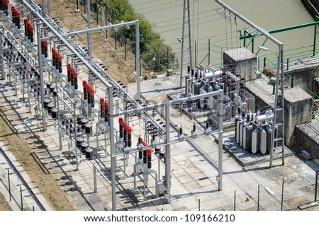 Power plant and transformers of hydroelectric station. - stock photo