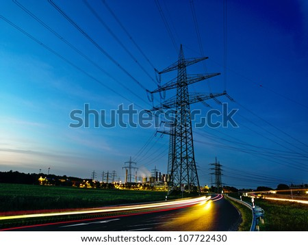 power plant by night - energy lines - stock photo