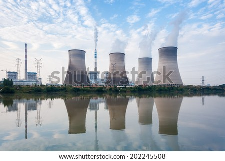 power plant, cooling towers and river in a silent afternoon