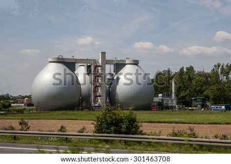 Power plant, field of photovoltaic panels and wind turbines, Germany - stock photo