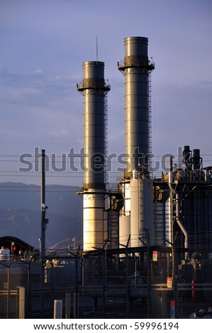 Power plant in the late afternoon sun. - stock photo