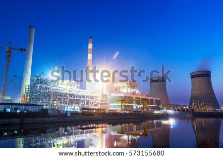 power plant near river at twilight