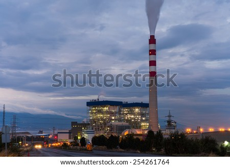 power plant night time use steam process from gas nature - stock photo