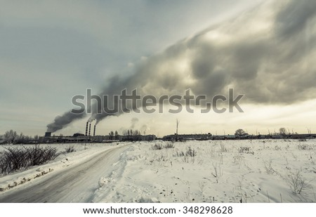 Power plant pollutes the environment, winter shot, photo - stock photo