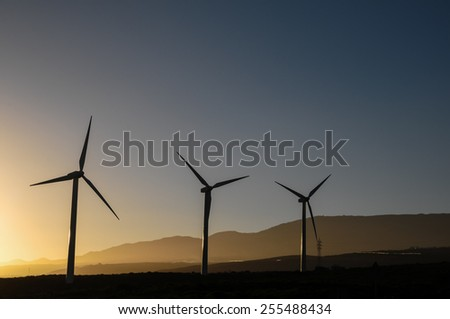 Power Plant Renewable Energy Wind Turbines and Solar Panels - stock photo