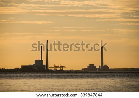 power plant silhouette at sunset
