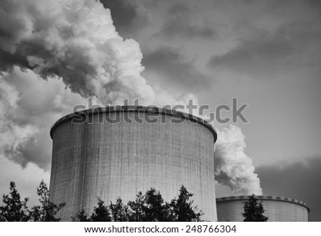 Power plant smoke chimney, monochrome detail - stock photo