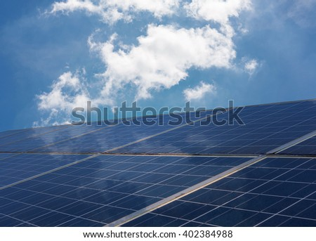 Power plant using renewable solar energy with blue sky and cloudy background - stock photo