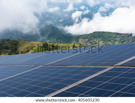 Power plant using renewable solar energy with mountains background