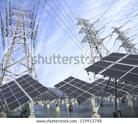Power plant using renewable solar energy with sun and Power transmission tower - stock photo