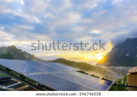 Power plant using renewable solar energy with sunset over the Gap in the Great Smoky Mountains background - stock photo