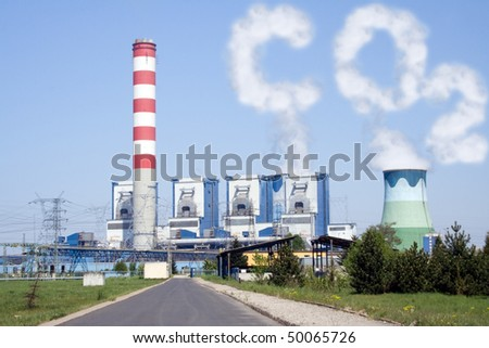 Power plant with chimney and cooling towers with CO2 clouds - stock photo