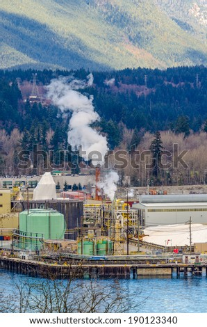 Power plants generating smokes - stock photo