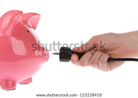 Power plug in a hand on a white background - stock photo